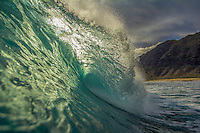 A breaking wave lit by the sun on the North Shore of O'ahu.