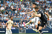 KANSAS CITY, KS - JUNE 26: Marco Farfan #32 Los Angeles FC heads the ball during a game between Los Angeles FC and Sporting Kansas City at Children's Mercy Park on June 26, 2021 in Kansas City, Kansas.
