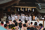 February  20th, 2016, Inazawa, Japan - Festival participants reaching the Haiden Hall of Konomiya Shrine which is the final destination of the festival on Saturday, February 20, 2016.<br /> The festival organised by Konomiya Shrine, takes place annually on the 13th of the lunar calendar. It is one of the oldest festivals in Japan. Since the old days, the participants are men only, mostly of the ages 24, 42 and 61, which are considered unlucky in Japan. By taking part in the festival they are hoping to avoid the bad luck throughout the coming year.