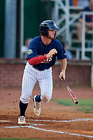 Elizabethton Twins catcher Andrew Cosgrove (5) runs to first base during a game against the Bristol Pirates on July 28, 2018 at Joe O'Brien Field in Elizabethton, Tennessee.  Elizabethton defeated Bristol 5-0.  (Mike Janes/Four Seam Images)