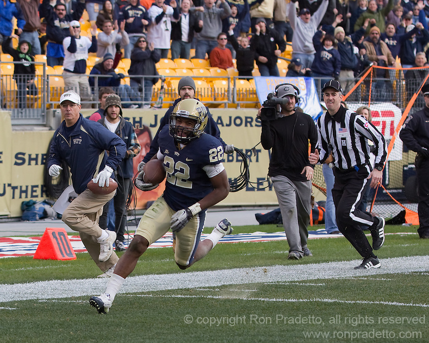 Pitt defensive back Antwuan Reed (22) returns a fumble 20 yards for a touchdown. The Pittsburgh Panthers beat the Syracuse Orange 33-20 at Heinz Field in Pittsburgh, Pennsylvania on December 3, 2011