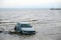 A BMW car is swept out to sea in Agia Triada