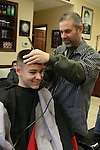WATERBURY, CT31 December 2013-123113LW04 - Mike Bordiere, right, cuts 14-year-old CJ Martere's hair at Salvatore's Barber Shop in Watertown Tuesday.<br /> Laraine Weschler Republican-American