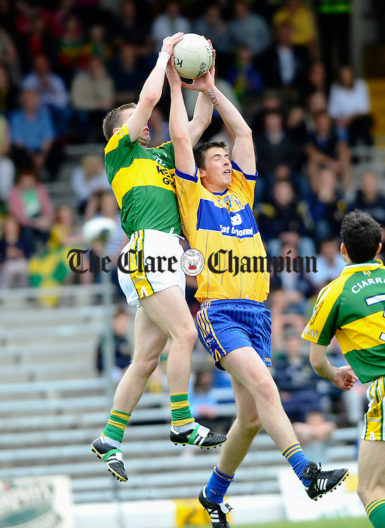 Kerry's Marc O Se amd Clare's Colm Dillon contest a ball during their senior championship game in Killarney. Photograph by John Kelly.