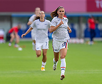 TOKYO, JAPAN - JULY 21: Alex Morgan #13 of the USWNT warms up before a game between Sweden and USWNT at Tokyo Stadium on July 21, 2021 in Tokyo, Japan.