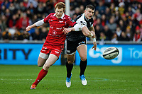 (L-R) Rhys Patchell of the Scarlets chases the ball against Scott Williams of the Ospreys during the Guinness Pro14 Round 11 match between the Ospreys and the Scarlets at the Liberty Stadium, Swansea, Wales, UK. Saturday 22 December 2018