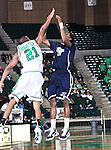 Jackson State Tigers guard Rod Melvin (3) shoots over North Texas Mean Green guard Shannon Shorter (21) in the game between the Jackson State Tigers and the University of North Texas Mean Green at the North Texas Coliseum,the Super Pit, in Denton, Texas. UNT defeated Jackson 68 to 49