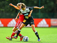 Aster Janssens (5) of Standard  and Justine Blave (22) of Eendracht Aalst battle for the ball during a female soccer game between Standard Femina de Liege and Eendracht Aalst dames on the fourth matchday in the 2021 - 2022 season of the Belgian Scooore Womens Super League , Saturday 11 th of September 2021  in Angleur , Belgium . PHOTO SPORTPIX   BERNARD GILLET