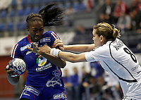 SERBIA, BELGRADE: France's Mariama Signate (L) vies with Montenegro's Marija Jovanovic  (R) during handball Women's World Championship match between France and Montenegroin Belgrade, Serbia on Wednesday, December 11, 2013. (credit image: Pedja Milosavljevic)