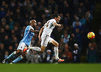 Jack Cork of Swansea City and Fabian Delph of Manchester City during the Barclays Premier League match between Manchester City and Swansea City played at the Etihad Stadium, Manchester on December 12th 2015