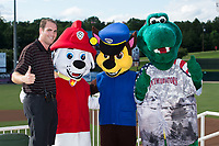 Kannapolis Intimidators Director of Communications Josh Feldman (left) poses for a photo with the Paw Patrol and mascot Tim E. Gator prior to the game against the Delmarva Shorebirds at Kannapolis Intimidators Stadium on June 30, 2017 in Kannapolis, North Carolina.  The Shorebirds defeated the Intimidators 6-4.  (Brian Westerholt/Four Seam Images)