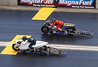 Jul 26, 2015; Morrison, CO, USA; NHRA pro stock motorcycle rider Steve Johnson (near) defeats Shawn Gann during the Mile High Nationals at Bandimere Speedway. Mandatory Credit: Mark J. Rebilas-USA TODAY Sports