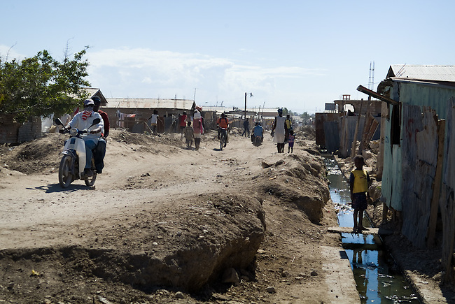 Streets coverd with mud. The rain after hurrican Ike in September 2008 and the following flood  covered the city of Gonaives with water and brought  scree and mud from the surrounding mountains into the valley. Thousends of familys lost their homes and still live in shelter camps, schools and comunity halls.