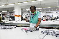 The fabrics cut according to a computer generated design. The fabrics are cut either by hand or by machines. Gazipur, near Dhaka, Bangladesh