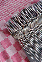 Stack of forks on a table