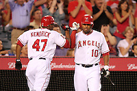 Los Angeles Angels second baseman Howie Kendrick #47 is greeted by teammate outfielder Vernon Wells #10 after hitting a home run against the Chicago White Sox at Angel Stadium on August 23, 2011 in Anaheim,California. Los Angeles defeated Chicago 5-4.(Larry Goren/Four Seam Images)