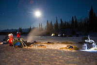 Teams rest under the moonlight at the Finger Lake checkpoint on Monday morning