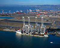 aerial photograph of large cranes manufactured by Zhen Hua Port Machinery in Shanghai for use at the Port of Oakland, Oakland, California