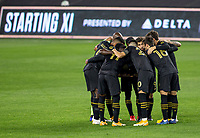 CARSON, CA - OCTOBER 28: The Los Angeles FC starting eleven huddle versus the Houston Dynamo during a game between Houston Dynamo and Los Angeles FC at Banc of California Stadium on October 28, 2020 in Carson, California.