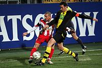 Flanke von Leon Andreasen (FSV Mainz 05) gegen Christoph Metzelder (Borussia Dortmund)