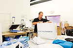 September 18, 2014. Raleigh, North Carolina.<br />  Chuck Sawyer boxes up t-shirts to be sent out to a client at his main retail and production franchise.<br />  Chuck Sawyer, 37, is the owner of three Instant Imprints franchises, specializing in promotional materials such as t-shirts,signs and mugs. Sawyer wishes he had more saved for retirement and is encouraging his none employees to start thinking about how they will save for when they get older.<br /> Publication: AARP Bulletin<br /> Editor: Jenna Isaacson-Fuller<br /> Model Released<br /> Reportage