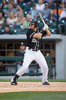 Tyler Colvin (26) of the Charlotte Knights at bat against the Louisville Bats at BB&T BallPark on May 12, 2015 in Charlotte, North Carolina.  The Knights defeated the Bats 4-0.  (Brian Westerholt/Four Seam Images)