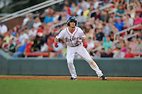 Center fielder Andrew Benintendi (2) of the Greenville Drive in a game against the Greensboro Grasshoppers on Wednesday, August 26, 2015, at Fluor Field at the West End in Greenville, South Carolina. Benintendi is a first-round pick of the Boston Red Sox in the 2015 First-Year Player Draft out of the University of Arkansas. Greenville won, 7-0. (Tom Priddy/Four Seam Images)