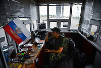 Insurgents chief in the control booth at the border crossing between Ukraine and Russia at Izvarine check point - one of border crossings controlled by Luhansk Peoples Republic. According to rebels around 5 thousand people leave Ukraine every day through Izvarine border crossing.