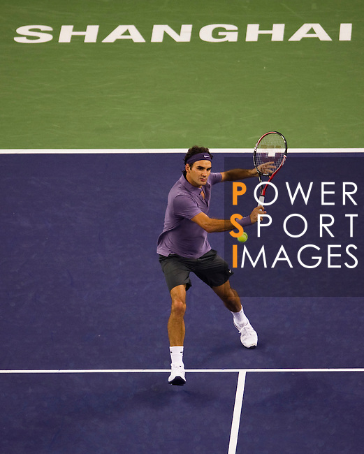 SHANGHAI, CHINA - OCTOBER 16:  Roger Federer of Switzerland returns a ball to Novak Djokovic of Serbia during day six of the 2010 Shanghai Rolex Masters at the Shanghai Qi Zhong Tennis Center on October 16, 2010 in Shanghai, China.  (Photo by Victor Fraile/The Power of Sport Images) *** Local Caption *** Roger Federer