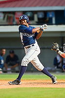 Yoel Araujo (2) of the Princeton Rays follows through on his swing against the Burlington Royals at Burlington Athletic Park on July 5, 2013 in Burlington, North Carolina.  The Royals defeated the Rays 5-1 in game one of a doubleheader.  (Brian Westerholt/Four Seam Images)