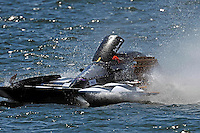 """Frame 2: Jay Gignac, GNH-55 """"Gi Wizz"""" returns to the pits with the left sponson blown out and damage to the right.  (Grand National Hydroplane(s)"""