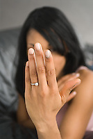 African American woman showing engagement ring<br />