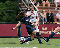 NEWTON, MA - AUGUST 29: Andi Barth #21 of Boston College crosses the ball as Kara Long #15 of University of Connecticut defends during a game between University of Connecticut and Boston College at Newton Campus Soccer Field on August 29, 2021 in Newton, Massachusetts.