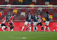 9th January 2021; Brentford Community Stadium, London, England; English FA Cup Football, Brentford FC versus Middlesbrough; Halil Dervisoglu of Brentford shoots and scores his sides 1st goal in the 35th minute from a Brentford cross to make it 1-0