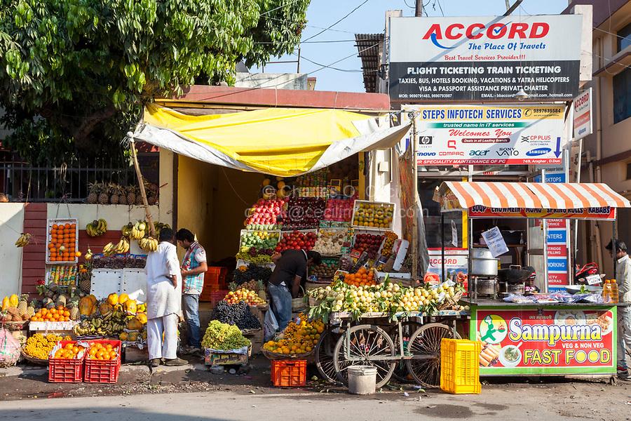 India, Dehradun.  Street Scene--Fast Food, Fruit Stand, Travel Agency.