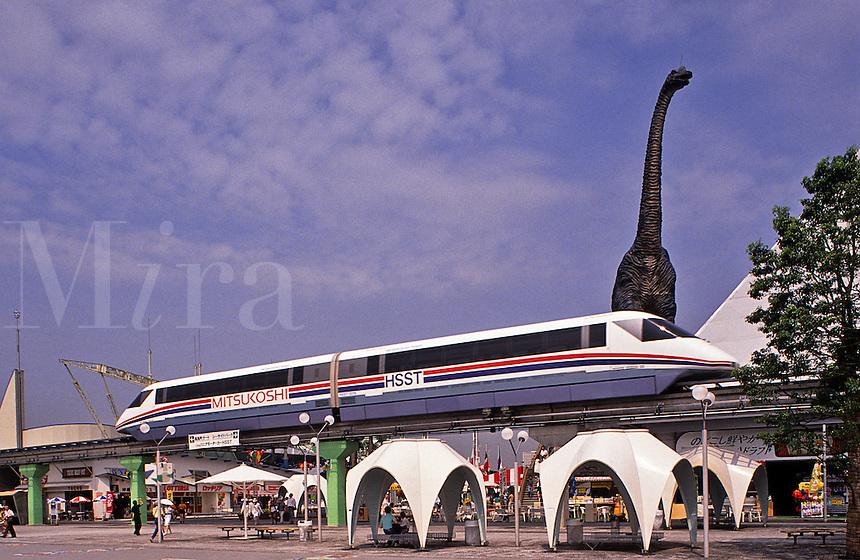 Japan. Yokohama Exhibition. HSST Maglev train on demonstration track, with dinosaur in background.