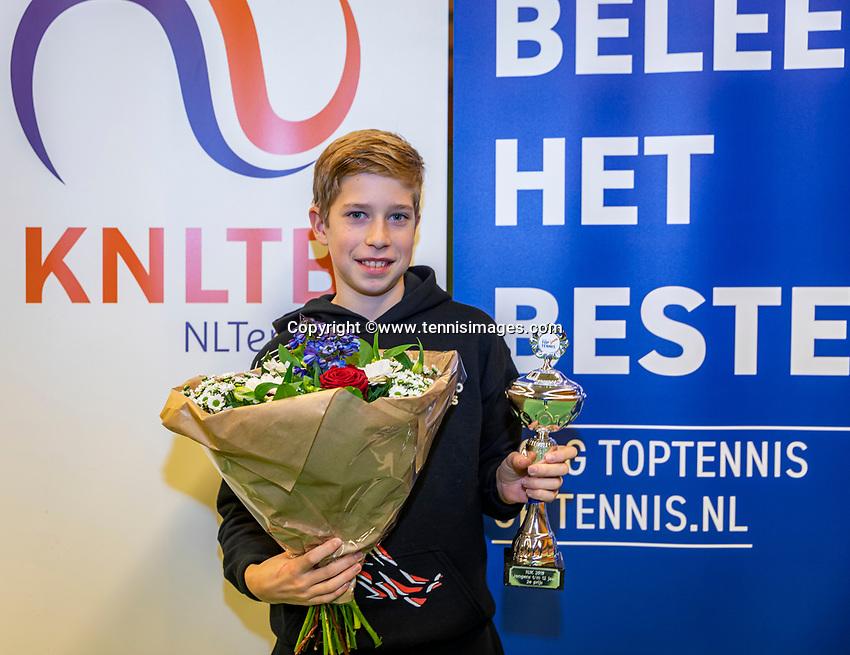 Wateringen, The Netherlands, December 1,  2019, De Rhijenhof , NOJK 12 and16 years, Runner up boys 12 years: Thijs Boogaard (NED) with the trophy<br /> Photo: www.tennisimages.com/Henk Koster