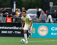 HARTFORD, CT - AUGUST 17: AJ Paterson #20 of Charleston Battery brings the ball forward during a game between Charleston Battery and Hartford Athletic at Dillon Stadium on August 17, 2021 in Hartford, Connecticut.