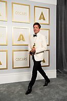On behalf of Denmark, Thomas Vinterberg poses backstage with the Oscar® for International Feature Film during the live ABC Telecast of The 93rd Oscars® at Union Station in Los Angeles, CA on Sunday, April 25, 2021.<br /> *Editorial Use Only*<br /> ©A.M.P.A.S.<br /> Image supplied by Capital Pictures