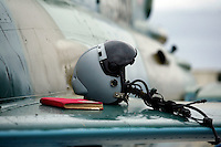 The helmet and note book of MiG-21 F pilot Dan Rogoz of the 95th Air Force Base from the Romanian Air Force. BOLD AVENGER 2007 (BAR 07), a NATO  air exercise at Ørland Main Air Station, Norway. BAR 07 involved air forces from 13 NATO member nations: Belgium, Canada, the Czech Republic, France, Germany, Greece, Norway, Poland, Romania, Spain, Turkey, the United Kingdom and the United States of America..The exercise was designed to provide training for units in tactical air operations, involving over 100 aircraft, including combat, tanker and airborne early warning aircraft and about 1,450 personnel.