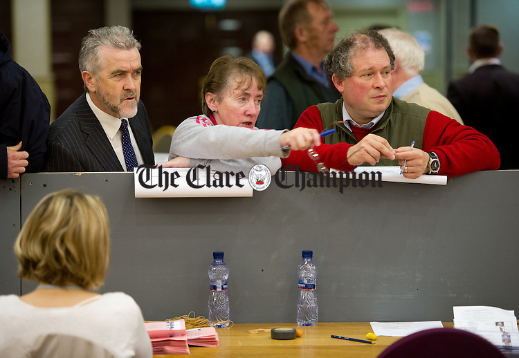 Tallys Gerry Flynn,Anne Hayes and Peter Moylan keep a watchful eye on event during the election count at The West county Hotel, Ennis. Photograph by John Kelly.