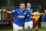 Fraser Aird scores the opener and celebrates during the Scottish Cup replay