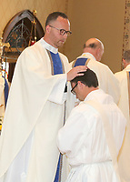 Fr. Derrick Aaron blesses his brother, Deacon Sean Aaron during Sean's ordination to the priesthood.