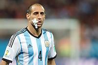 Pablo Zabaleta of Argentina with a face injury