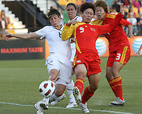 Amy LePeilbet #6 of the USA WNT clears the ball from Yihang Wang #9 of the PRC WNT during an international friendly match at KSU Soccer Stadium, on October 2 2010 in Kennesaw, Georgia. USA won 2-1.