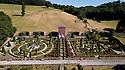 """19/06/18<br /> <br /> ***With video  https://www.youtube.com/watch?v=dRLkN49V02k  ***<br /> <br /> GV from drone showing rose garden and parched 'One Tree Hill' in the background.<br /> <br /> It's not just a 'good year for the roses', it might be the best ever year for the roses.<br /> <br /> The colours from a rose garden in the Derbyshire Dales stand out like an oasis surrounded by parched fields because, unbelievably, the roses need NO water to bloom.<br /> <br /> Julie Thomas (59) who owns Hopton Hall near Ashbourne said: """"The roses are the best they've ever been, they love the dry hot and sunny conditions - we don't even need to water them. <br /> <br /> """"Usually the rain would knock the petals off and we be busy dead-heading at this time of year but there's hardly anything to do at the moment. The blooms are in a kind of drought state - the flowers are staying for much longer than usual. And there are lots more flowers coming too.<br /> <br /> The classic walled english rose garden was planted with 2000 roses 12 years ago by estate manager, Spencer Tallis (51). He planted all the roses and plants in the garden in 2004 and has since made it his life's work tending them.<br /> <br /> """"I do have to water the box hedges a little but the roses are looking after themselves. Normally at this time of year we'd all be busy dead-heading but there's hardly anything to do at the moment""""<br /> <br /> Julie and her family bought the property eight years ago and have continued to plant and care for the rose garden and now open the garden for visitors.<br /> <br /> All Rights Reserved: F Stop Press Ltd. +44(0)1335 344240 www.fstoppress.com www.rkpphotography.co.uk"""