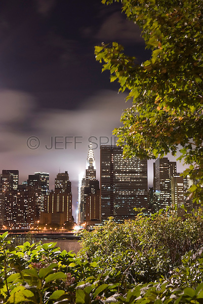 AVAILABLE FROM JEFF AS A FINE ART PRINT.<br /> <br /> AVAILABLE FROM CORBIS FOR COMMERCIAL AND EDITORIAL LICENSING.  Please go to www.corbis.com and search for image # 42-27340576.<br /> <br /> Chrysler Building and Midtown Manhattan Viewed from Queens on a Cloudy Night, New York City, New York State, USA