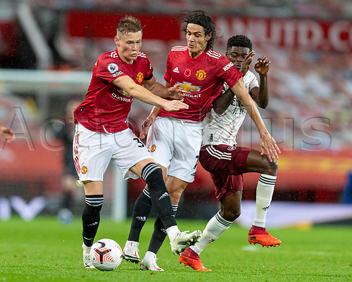 1st November 2020, Old Trafford, Manchester, England;  Manchester Uniteds Scott McTominay and Edinson Cavani get in each others way during the English Premier League match between Manchester United FC and Arsenal FC at Old Trafford