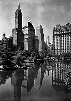Reflecting Pool: New York city views. View of plaza buildings, over park lake. Jan. 1933.