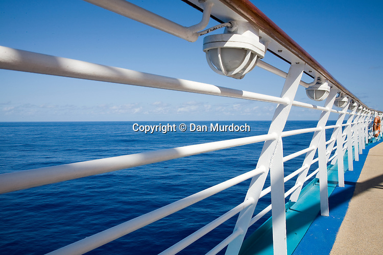 """The railing on the upper deck of the Royal Caribbean cruise ship """"Explorer of the Seas""""."""